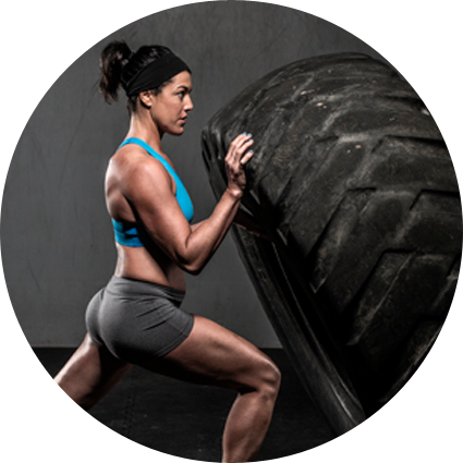 CrossFit athlete and fit mom Tate Fisher exercising with tire flips
