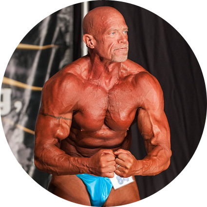 Master's Bodybuilder Tim Nassen flexing on stage